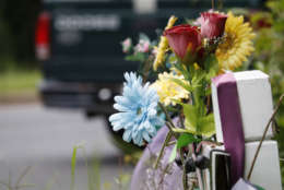 A memorial sits near the Bethesda intersection, where safety concerns are being addressed. (WTOP/Kate Ryan)