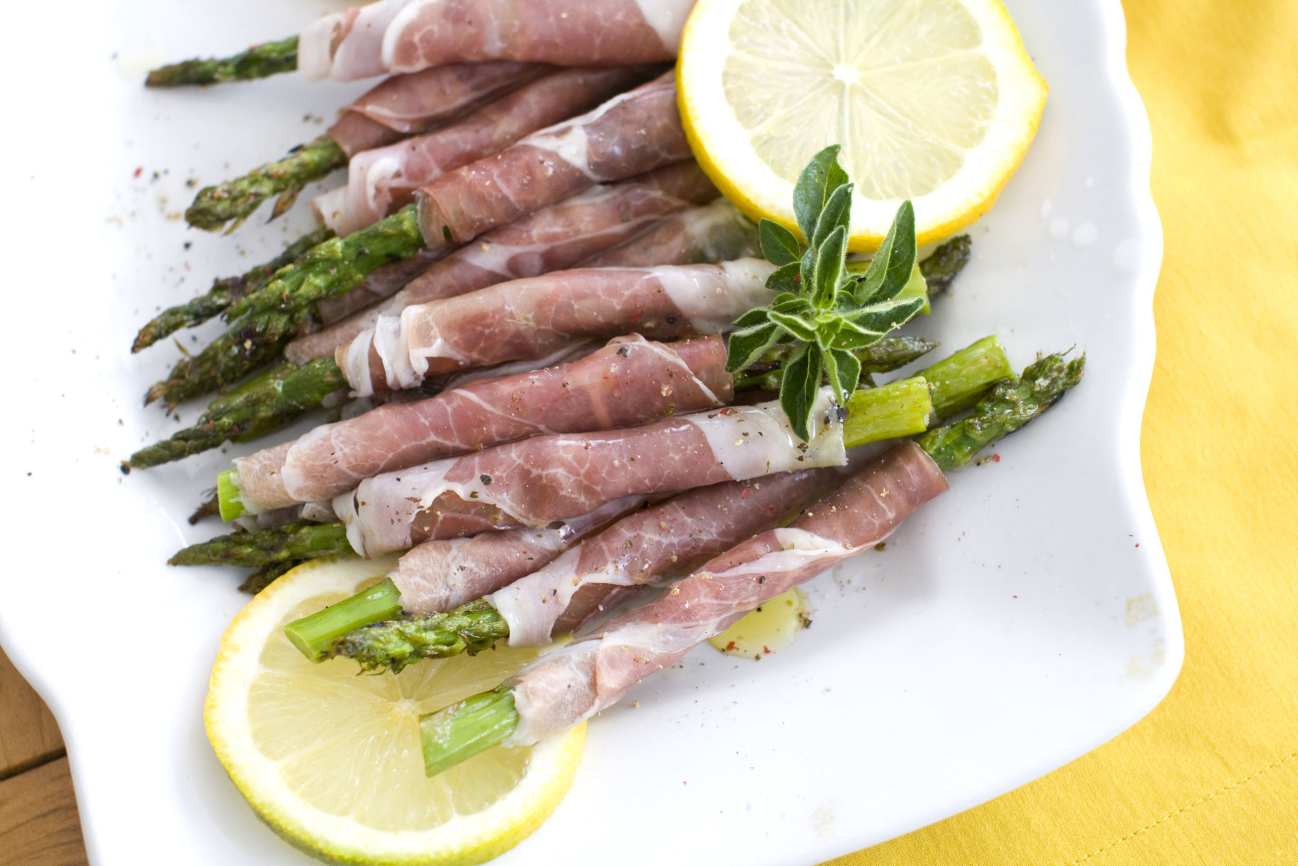 Prosciutto-wrapped grilled spring asparagus is seen in this photo taken Monday, March 5, 2012 in Concord, N.H. (AP Photo/Matthew Mead)