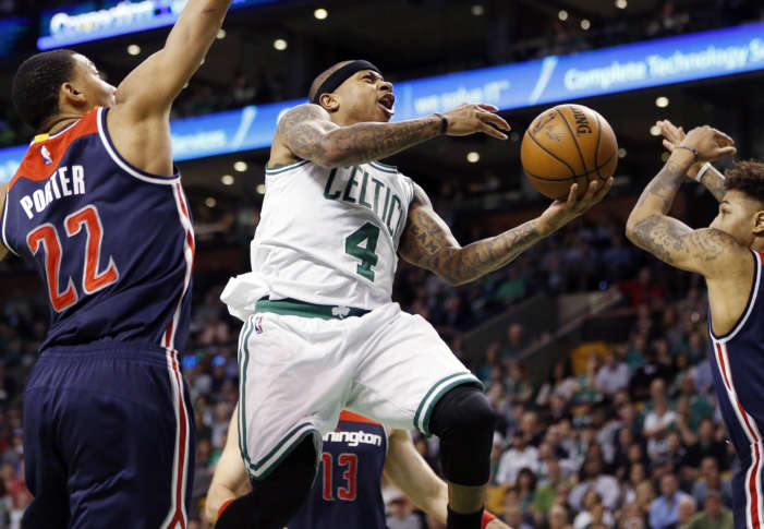 89eca341d2f4 Boston Celtics  Isaiah Thomas (4) goes up to shoot against Washington  Wizards  Otto Porter Jr. (22) during the second quarter of a second-round  NBA playoff ...
