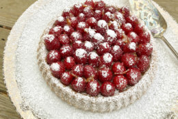 This Dec. 4, 2017 photo shows an orange and raspberry tart in Bethesda, Md. This dish is from a recipe by Melissa d'Arabian. (Melissa d'Arabian via AP)