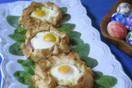 This March 2018 photo shows eggs baked in pastry nests made of phyllo in New York. This dish is from a recipe by Sara Moulton. (Sara Moulton via AP)