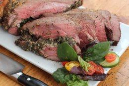 This Jan. 18, 2016 photo shows slow roasted herbed leg of lamb in Concord, N.H. This dish is from a recipe by Sara Moulton. (AP Photo/Matthew Mead)