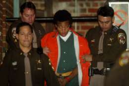 FILE - In this Tuesday, Jan. 14, 2003 file photo, sniper shooting suspect John Lee Malvo is escorted from court after his preliminary hearing in Fairfax, Va.  (AP Photo/ Pablo Martinez Monsivais, File)