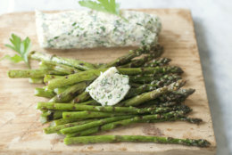 This April 21, 2014, photo shows grilled asparagus with lemon butter in Concord, N.H. (AP Photo/Matthew Mead)