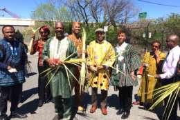 Bishop Rainey Cheeks of Inner Light Ministries Church of Southeast D.C. and some of his congregants handed out palm fronds to commemorate Palm Sunday during the third annual Anacostia River Festival on Sunday. (WTOP/Dick Uliano)