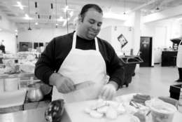 Syrian native Majed* attended five years of culinary school and worked in restaurants in Syria and Jordan before he and his family moved to the U.S. 10 months ago. After originally settling in Arizona and working at a Mexican-American restaurant, Majed now spends his days at Foodhini, whipping up dishes such as shawarma and moussaka. (Courtesy Foodhini)
