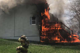 Firefighters respond to a town house on Dunloring Drive in Upper Marlboro on April 3 that investigators say was set intentionally. (Courtesy Paul Hawkins, PGFD Observer)