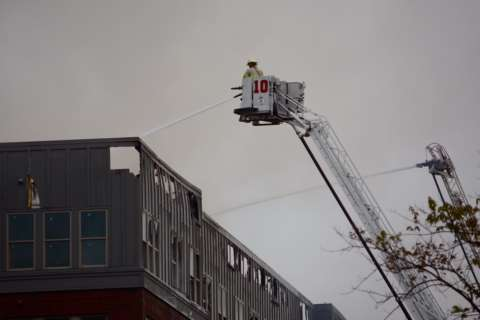 Fire crews are still on the scene as College Park blaze smolders
