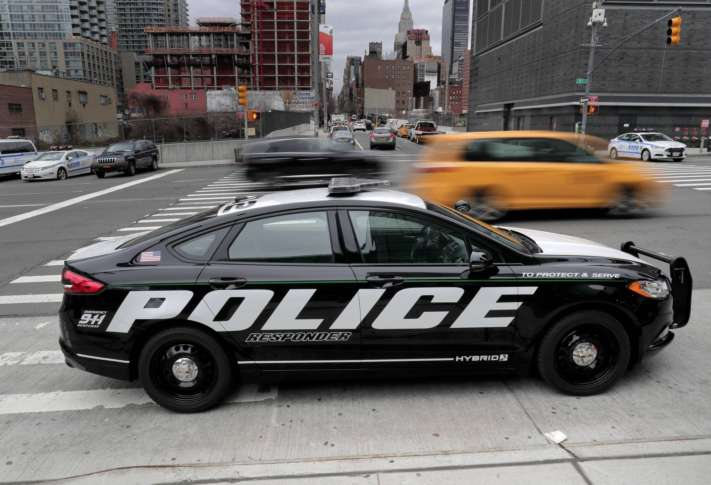 Ford_Hybrid_Police_Car_87990 In this Friday April 7 2017 photo a prototype of the Ford Fusion police hybrid car sits along 11th Avenue in New York. Ford ... & Ford says hybrid police car catches bad guys saves gas too | WTOP markmcfarlin.com