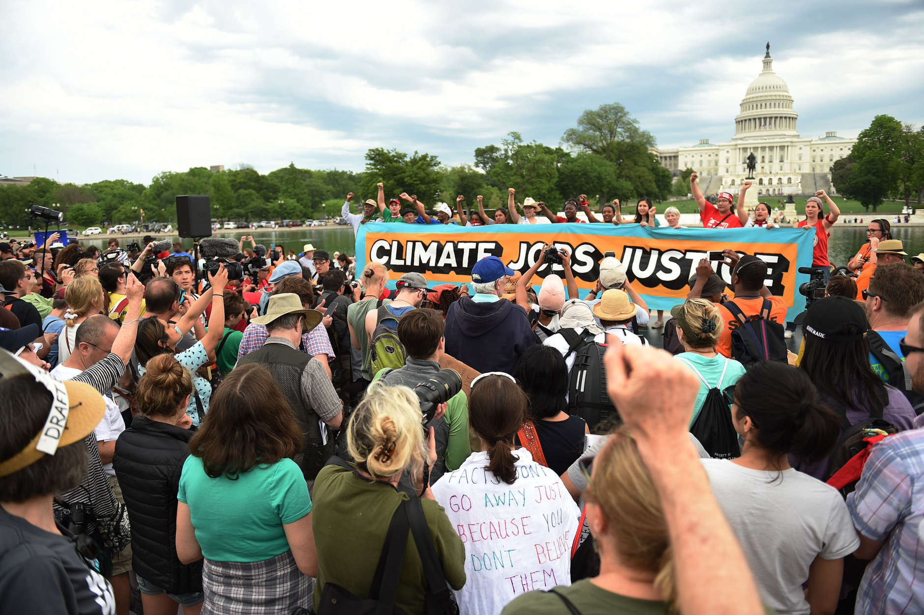 People gather near the U.S. Capitol for the People's Climate Movement before marching to the White House to protest President Donald Trump's enviromental policies April 29, 2017 in Washington, DC. Demonstrators across the country are gathering to demand  a clean energy economy. (Photo by Astrid Riecken/Getty Images)