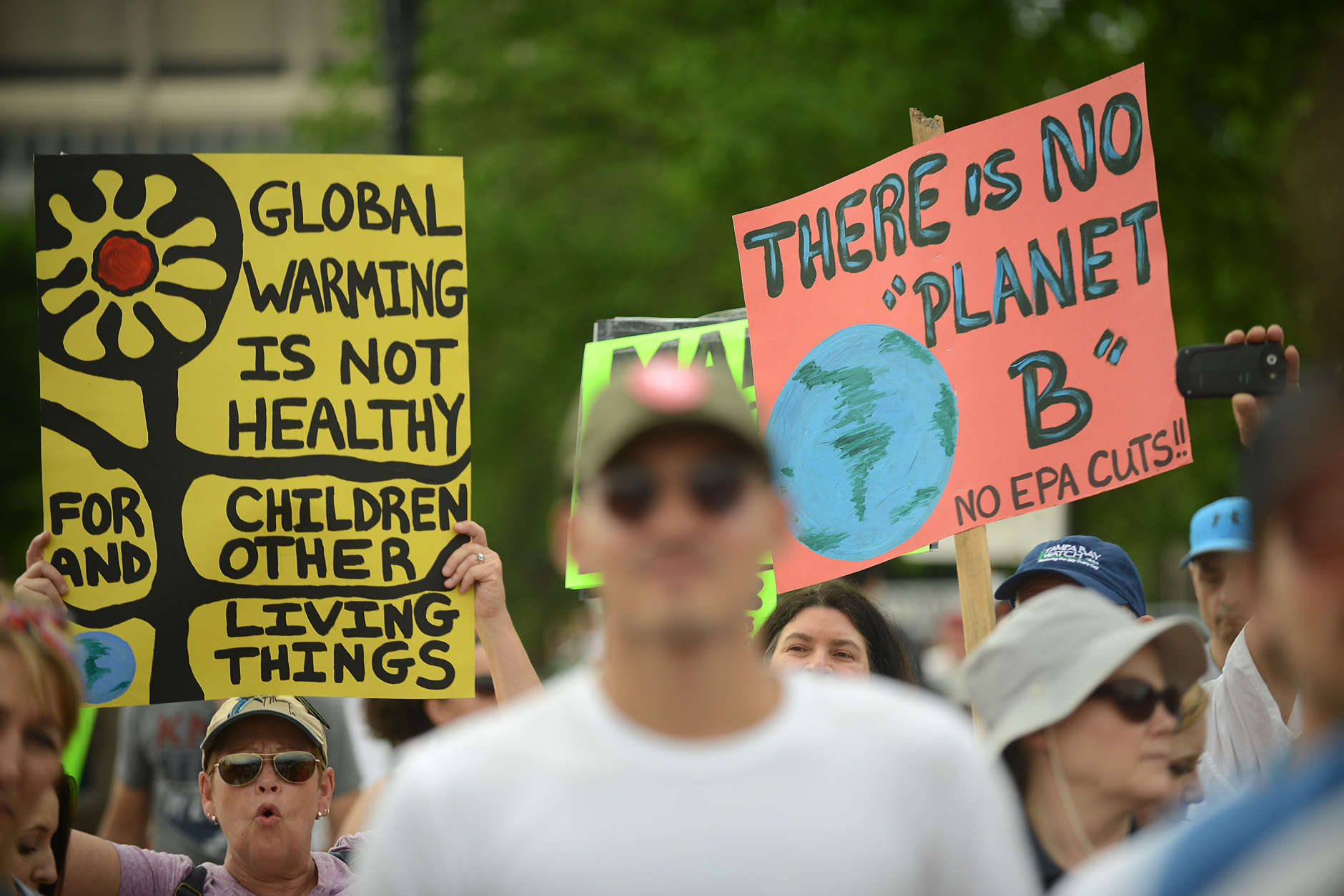 Thousands of people across the U.S. marched Saturday on President Donald Trump's 100th day in office to demand action on climate change. (Photo by Astrid Riecken/Getty Images)