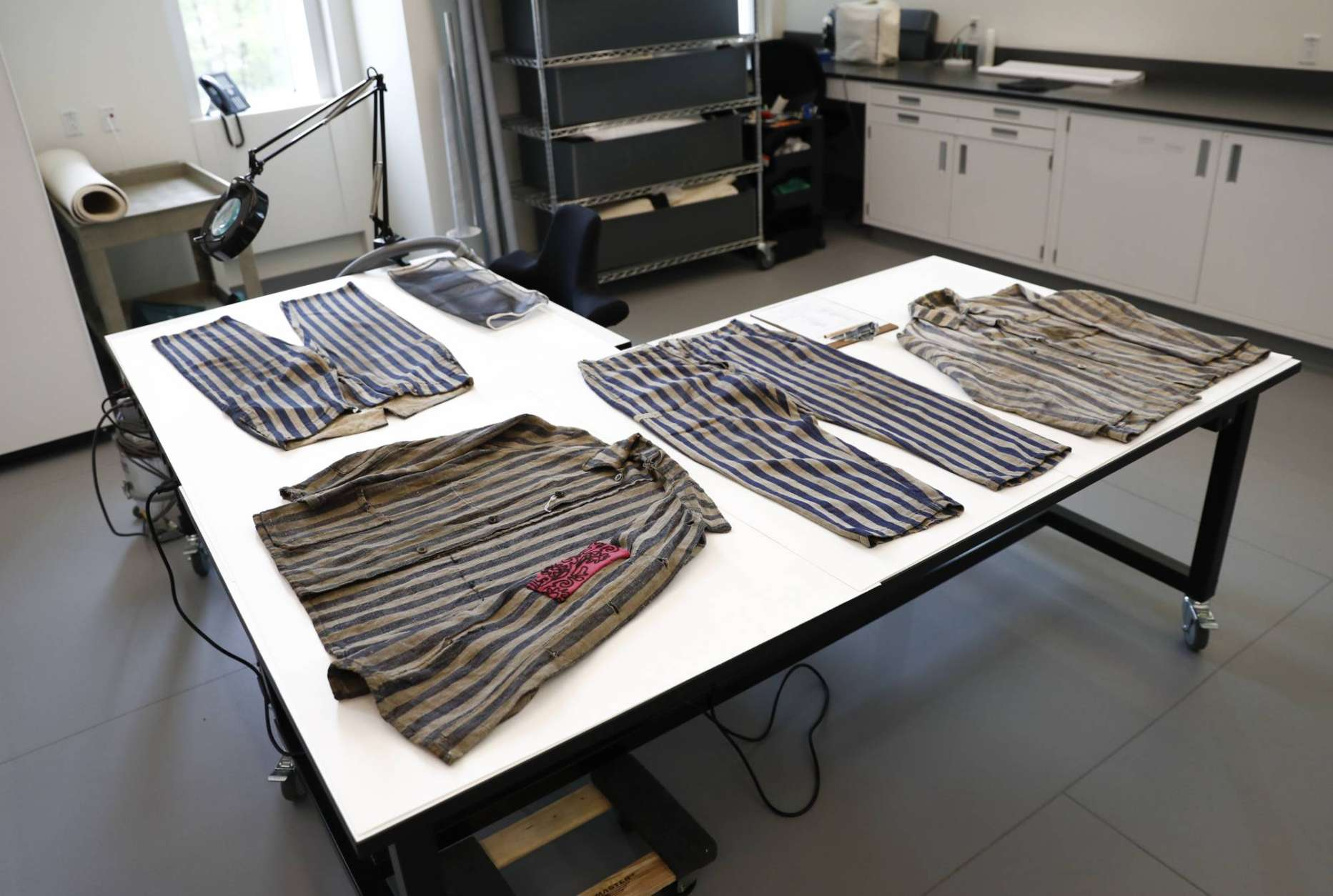 Clothing worn in a work camp by an uncle and nephew who where saved by being on Schindler's List is seen at the U.S. Holocaust Memorial Museum's David and Fela Shapell Family Collections, Conservation and Research Center in Bowie, Md., Monday, April 24, 2017. The Shapell Center is a new state-of-the-art facility that will house the collection of record of the Holocaust. (AP Photo/Carolyn Kaster)