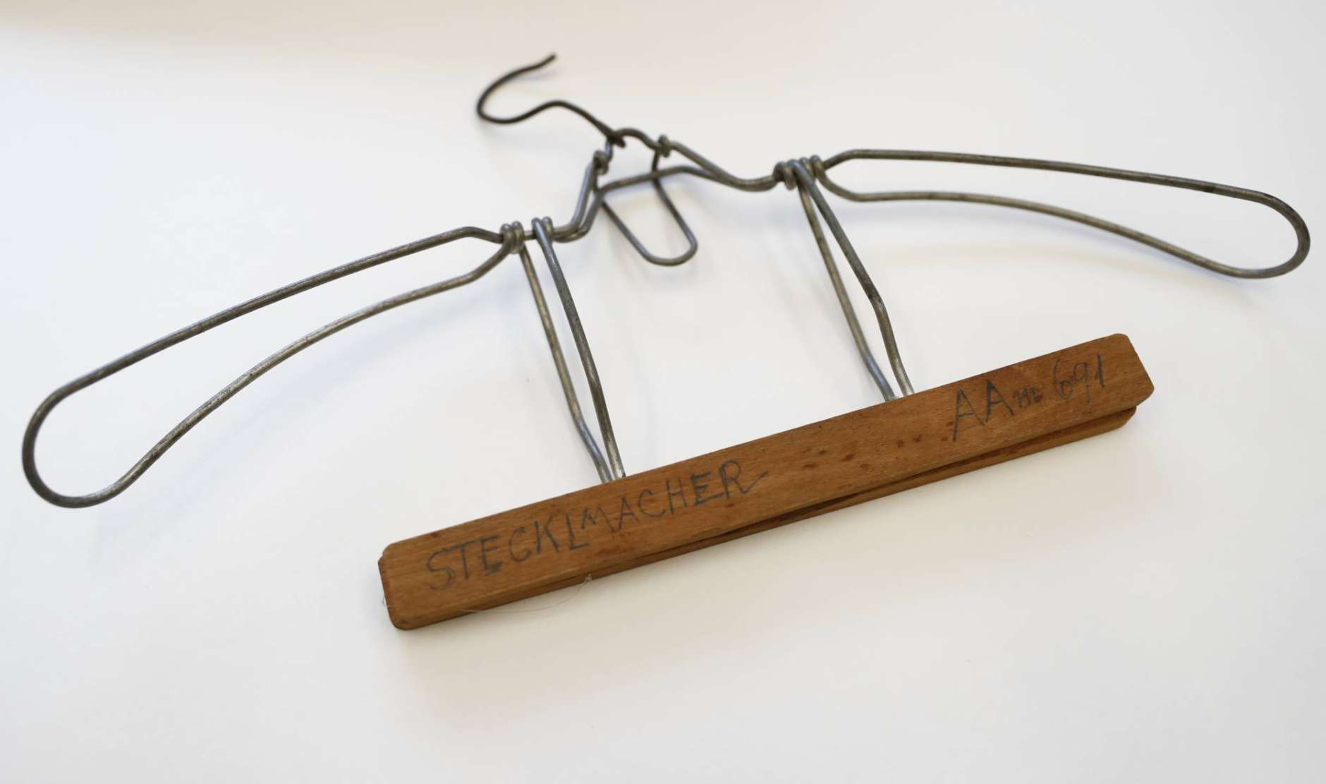 A coat hanger belonging to Fritz Steckelmacher from the time of the Holocaust is seen on display at the U.S. Holocaust Memorial Museum's David and Fela Shapell Family Collections, Conservation and Research Center in Bowie, Md., Monday, April 24, 2017. The Shapell Center is a new state-of-the-art facility that will house the collection of record of the Holocaust. (AP Photo/Carolyn Kaster)