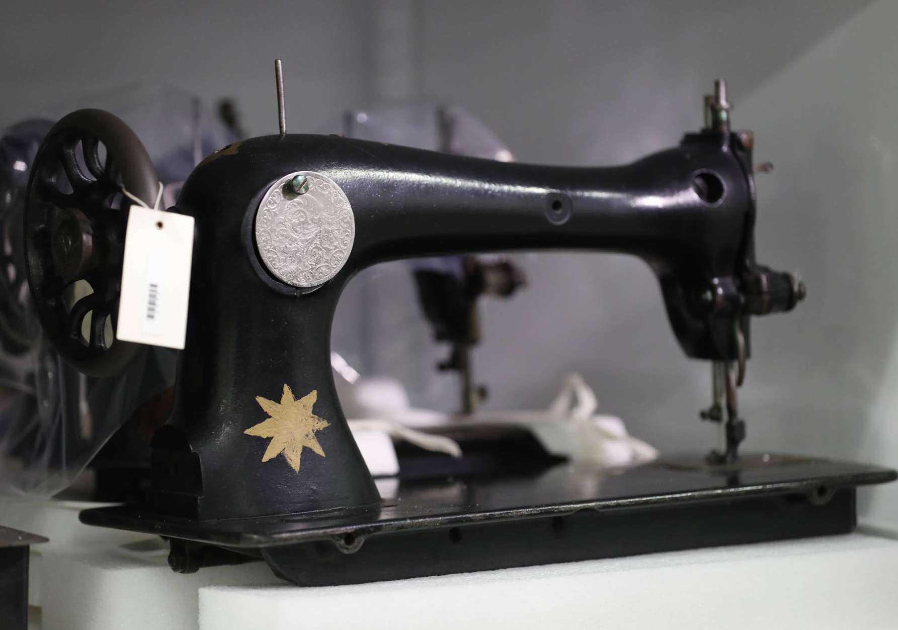 A sewing machine used during the time of the Holocaust is seen in the Personal Artifacts Vault at the U.S. Holocaust Memorial Museum's David and Fela Shapell Family Collections, Conservation and Research Center in Bowie, Md., Monday, April 24, 2017. The Shapell Center is a new state-of-the-art facility that will house the collection of record of the Holocaust. (AP Photo/Carolyn Kaster)