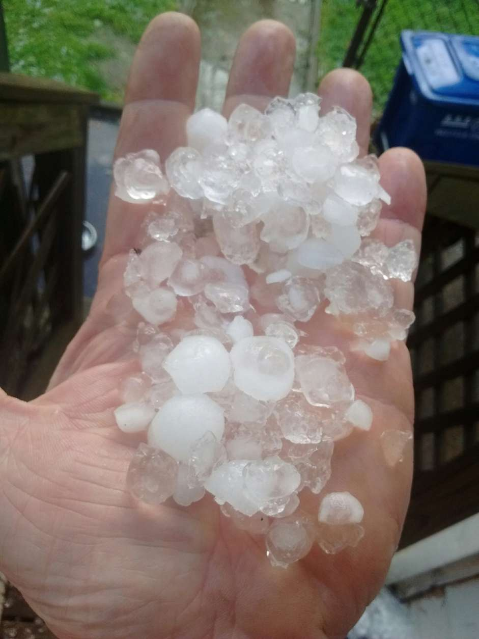 Photo of person with hail in their hand