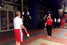Jugglers entertain the crowds outside the Verizon Center in Washington, D.C. The Wizards and the Celtics play Game 4 of the NBA Playoffs on Sunday, May 7, 2017. (WTOP/Jenny Glick)