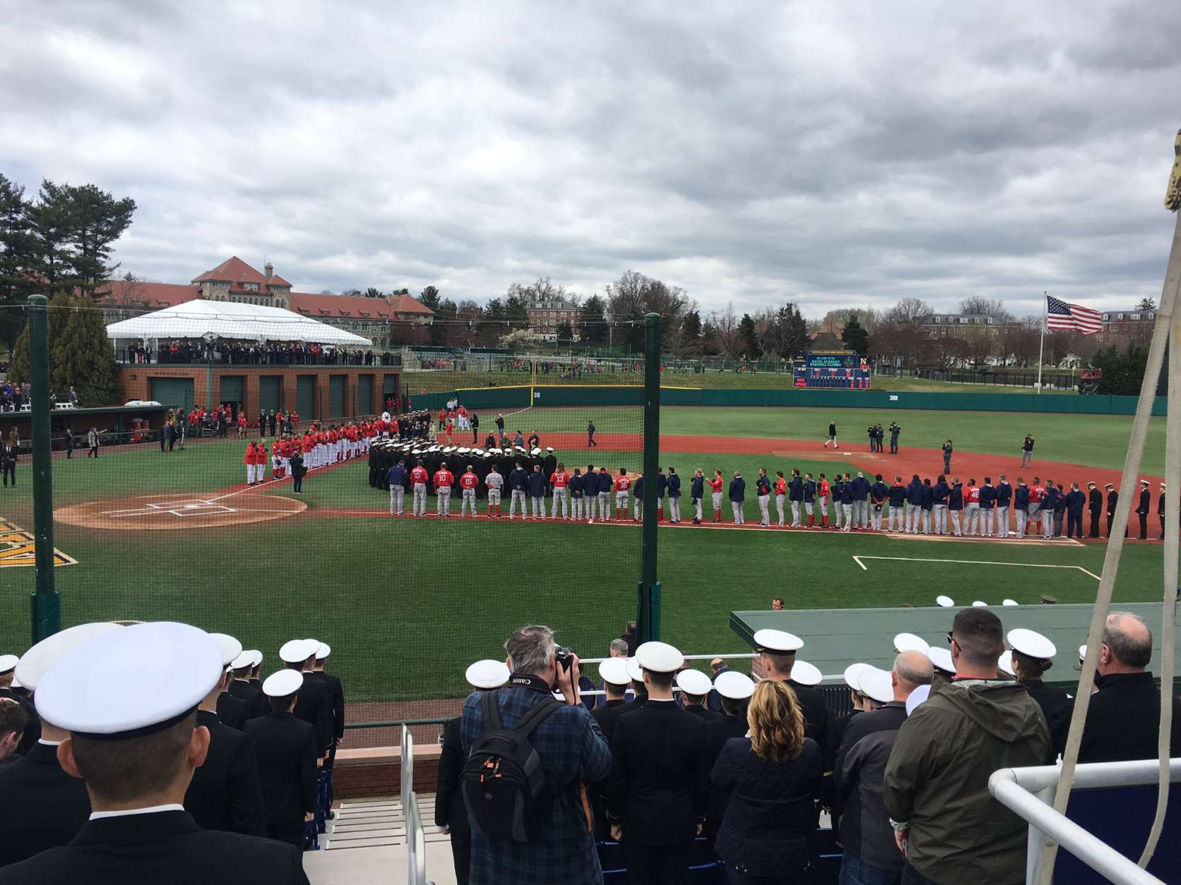 The Nationals and the Red Sox stand for the national anthem at the Naval Academy. (WTOP/George Wallace)
