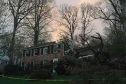 """""""A rainbow just briefly appeared above the destruction here on Toll House Road in Annandale."""" (WTOP/Michelle Basch)"""