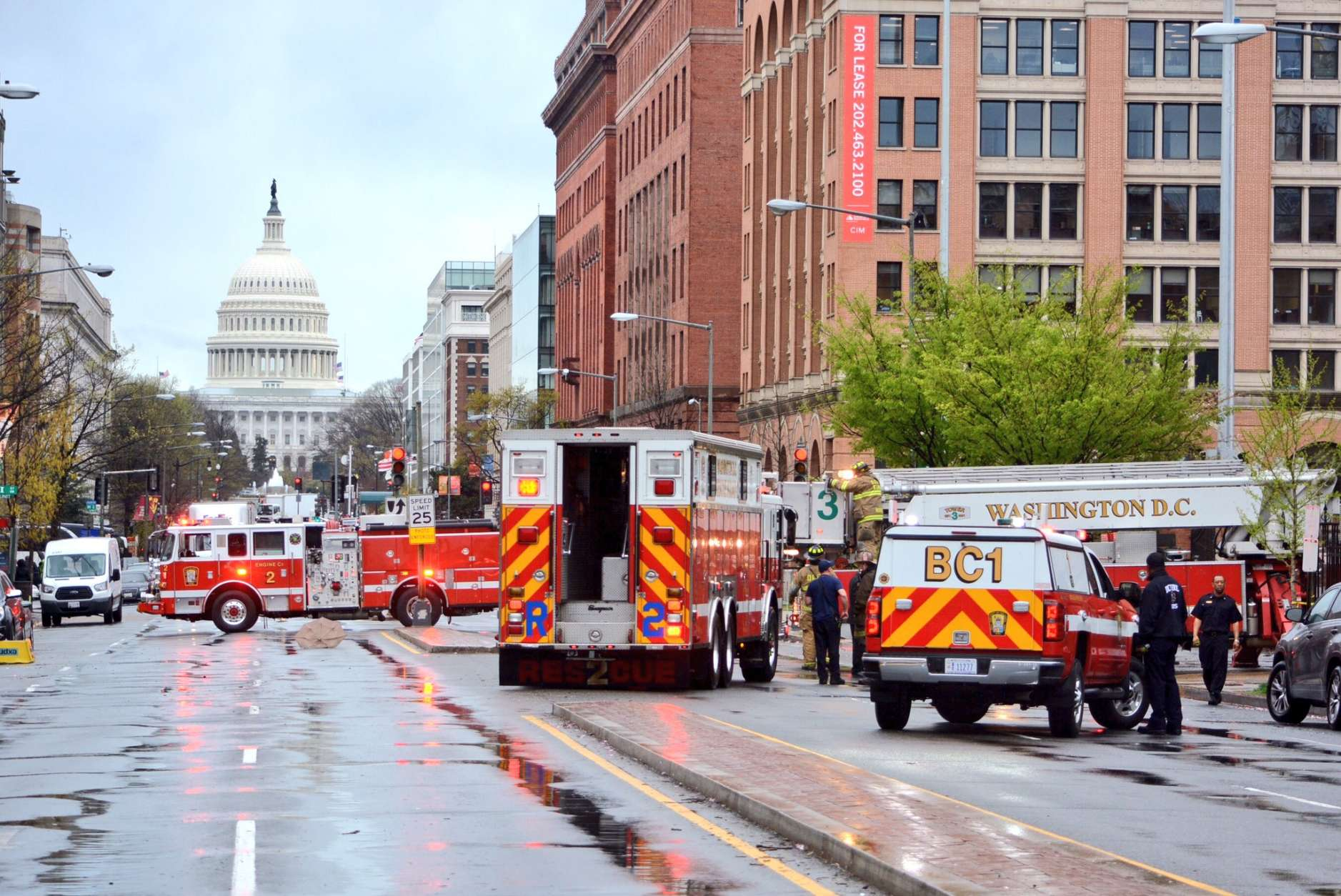 North Capitol Street is blocked by firefighters responding to the wind damage to the roof at St. Aloysius. (WTOP/Dave Dildine)