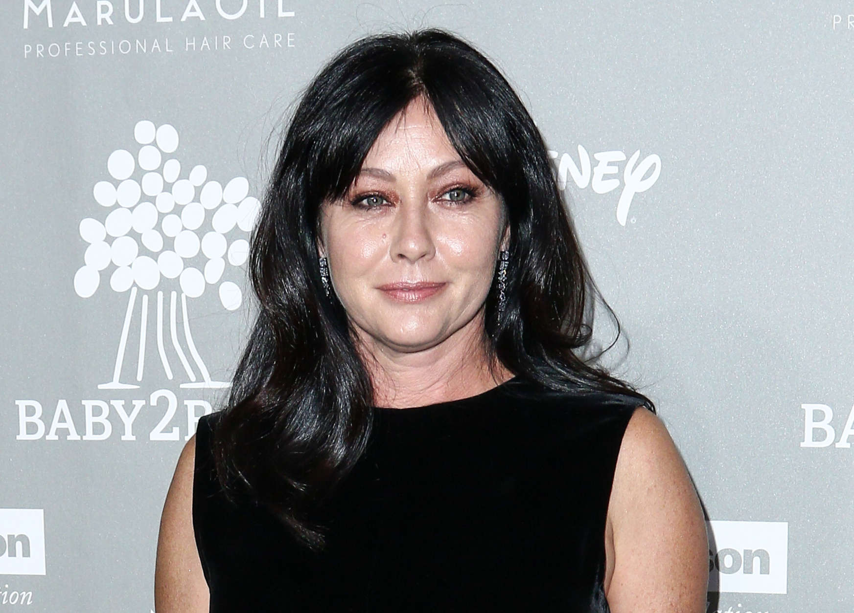 FILE - In this Nov. 14, 2015 file photo, Shannen Doherty attends the 4th Annual Baby2Baby Gala in Culver City, Calif. Court records show Doherty has reached a conditional settlement with her former business managers in a lawsuit in which she accused them of mismanaging her money and causing a lapse in her health insurance that led to a delay in her being diagnosed with breast cancer. The settlement notice filed