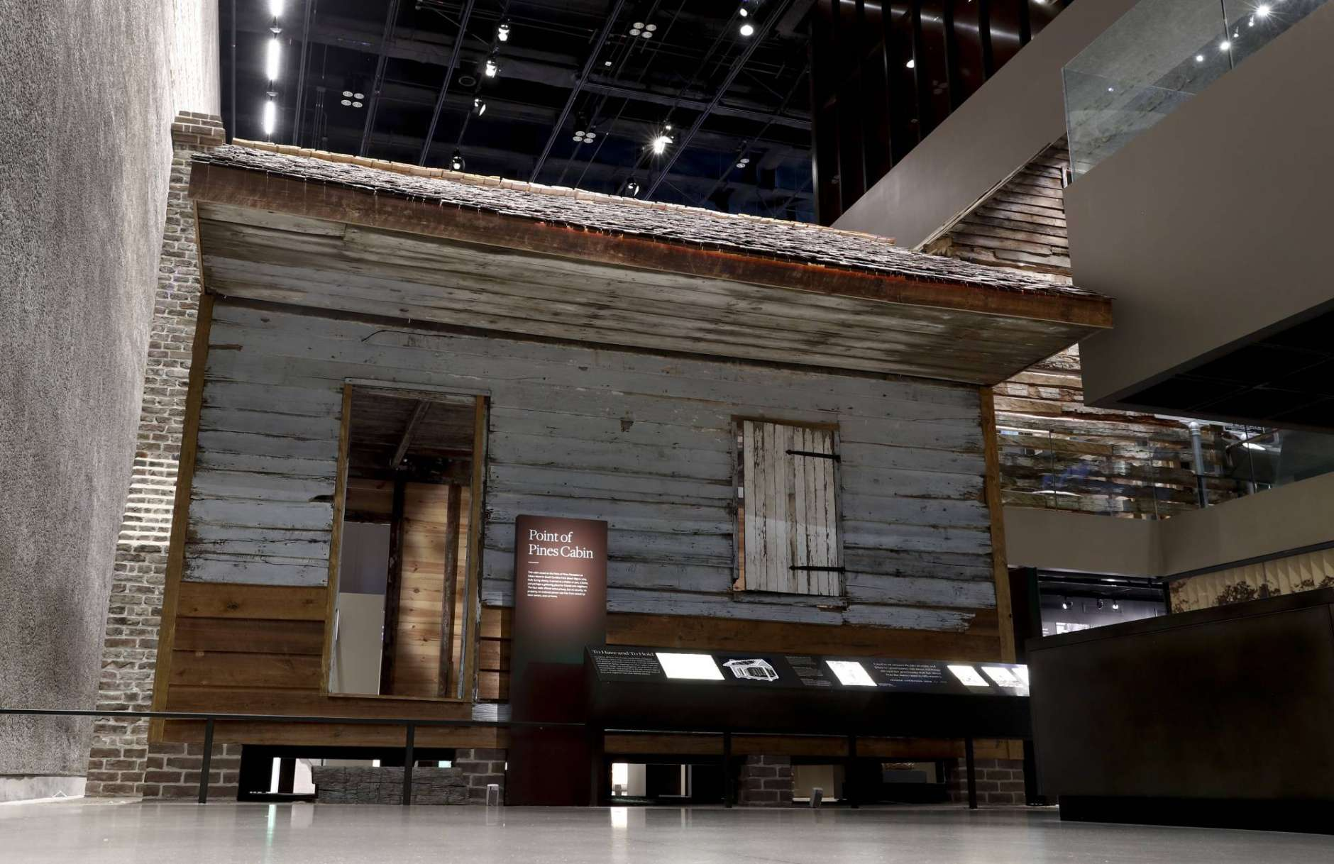 The front of a slave cabin from Edisto Island, S.C. on display at the National Museum of African American History in Washington, Tuesday, April 11, 2017. The two-room wood cabin dates to the 1850's and is prominently displayed in the history galleries of the museum. It is believed to be one of the oldest preserved slave cabins in the U.S. (AP Photo/Carolyn Kaster)