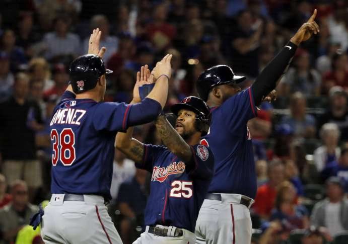 Rangers avoid another series sweep with 14-3 win over Twins