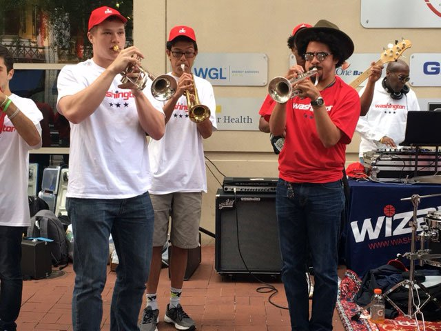 The band, 24 Infinity Outreach, performs as crowds arrive at the Verizon Center for the Washington Wizards game against the Boston Celtics on Sunday, May 7, 2017. (WTOP/Jenny Glick)