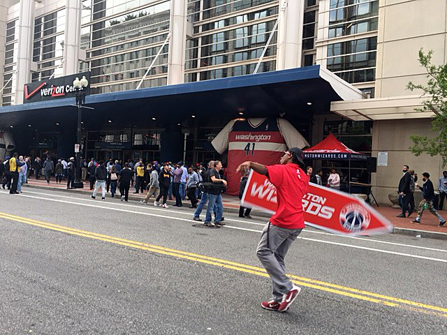 A sign flipper entertains the crowd outside the Verizon Center on Sunday, May 7, 2017. The Wizards and the Celtics play Game 4 of the NBA Playoffs in D.C. (WTOP/Jenny Glick)