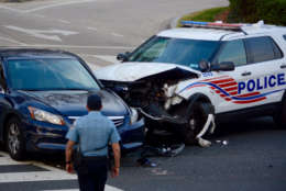 There were no serious injuries in this crash between a car and a D.C. police cruiser Saturday. (WTOP/Dave Dildine)