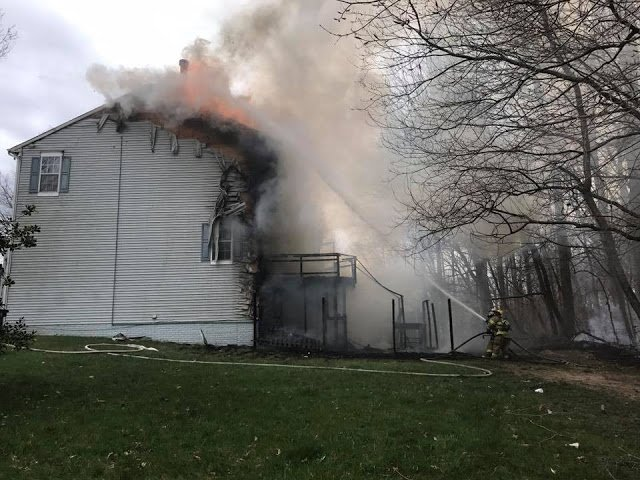 The fire spread rapidly  behind the house, said Mark Brady with the Prince George's County Fire Department. (Courtesy Paul Hawkins, PGFD Observer)