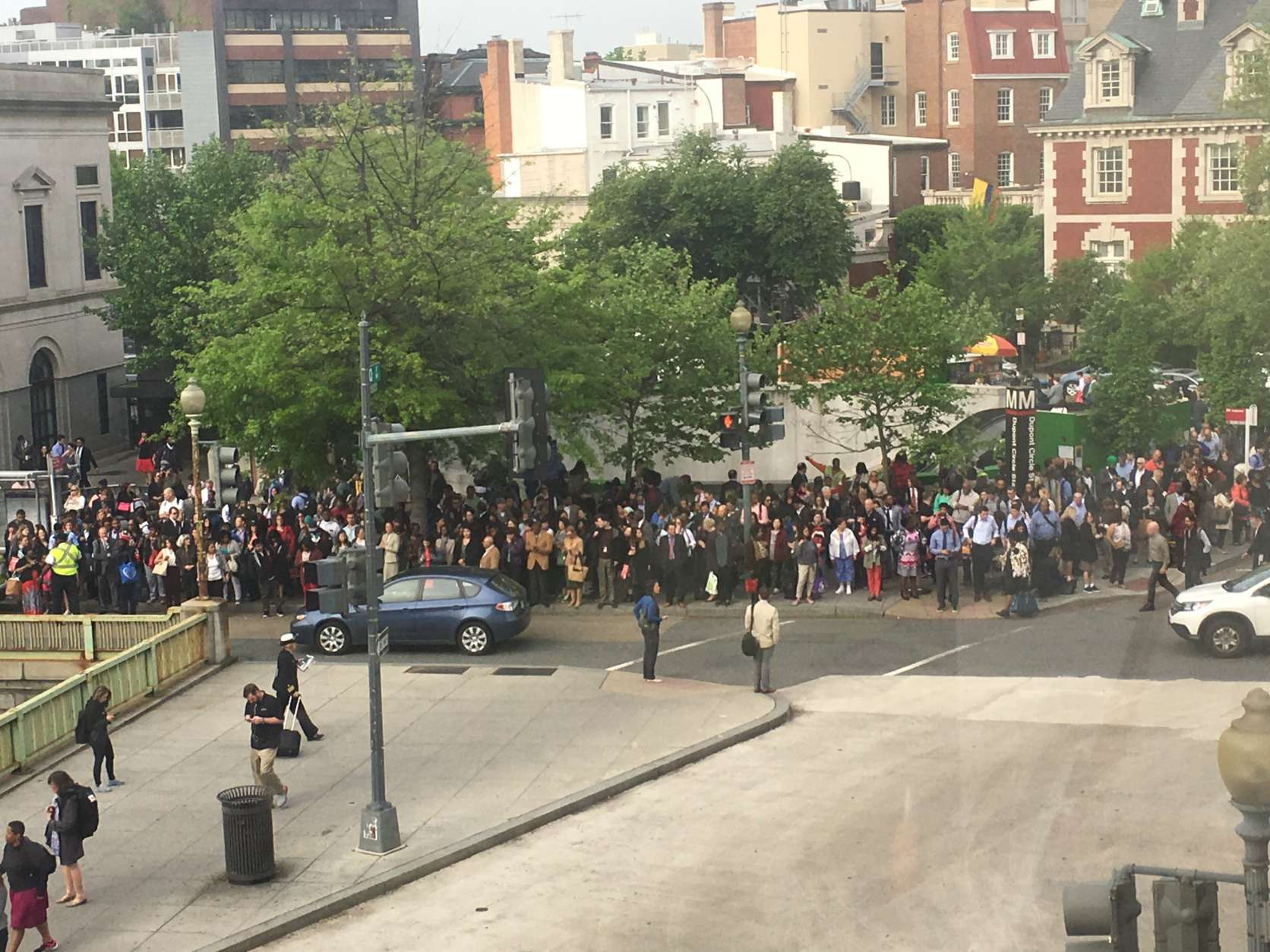 Huge morning crowds outside the Dupont Circle Metro station Thursday morning amid reports of smoke in a tunnel. (WTOP/Sarah Nania)