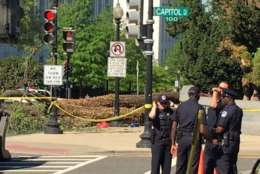 The tree that came down is seen in the background. (WTOP/Rob Stallworth)