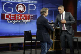 """Republican presidential candidate, Sen. Rand Paul, R-Ky., left, talks with Trevor Noah after taping a segment of the """"The Daily Show with Trevor Noah,"""" Wednesday, Jan. 13, 2016, in New York. After recent polls in Iowa and New Hampshire left him out of Thursday's prime-time presidential debate on the Fox Business Network, Paul has asked Republican Party leaders to include him in the main stage debate, using the results of a new poll in Iowa as leverage. (AP Photo/Julie Jacobson)"""