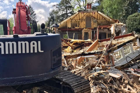 Demolition begins at posh DC home where 4 were killed