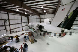 **FILE**A General Dynamics Gulfstream IV owned by Lyon Aviation undergoes an inspection at Pittsfield Municipal Airport in this April 13, 2007 file photo, in Pittsfield, Mass. Defense contractor General Dynamics Corp. said Wednesday, July 25, 2007 its second-quarter earnings fell 19 percent from a year-ago period that was boosted by an asset sale, but said profits from ongoing operations rose on demand for its warships and aerospace products. (AP Photo/Nathaniel Brooks, file)