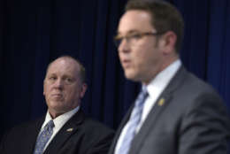 U.S. Immigration and Customs Enforcement acting director Thomas Homan, left, listens as Homeland Security Investigations deputy executive associate director Derek Benner, right, speaks during a news conference in Washington, Thursday, May 11, 2017, to announce the results of a national operation targeting gang members and associates. (AP Photo/Susan Walsh)