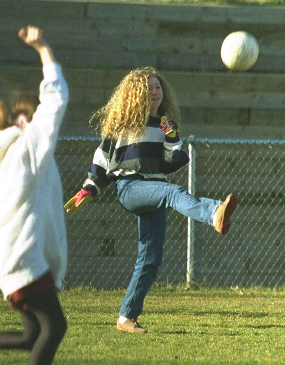 Chelsea Clinton, the president's 12-year-old daughter, clears the ball after making a save in goal during a soccer game at her school Monday. Chelsea attended her first day at Sidwell Friends School in northwest Washington.  (AP Photo/Charles Tasnadi)