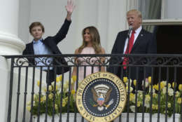 In this April 17, 2017, file photo, President Donald Trump, accompanied by first Lady Melania Trump, introduces their son Barron Trump from the Truman Balcony of the White House in Washington.  (AP Photo/Susan Walsh, File)
