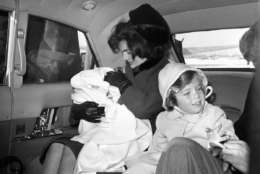 Caroline Kennedy, seen here in Feb. 1961 alongside her mother Jacqueline Kennedy, in a limousine at Washington National Airport, attended first grade in a special classroom set up on the third floor of the White House. (AP photo)
