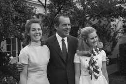 Julie Nixon Eisenhower, left, and Tricia Nixon, right, pose with their father President Richard Nixon in June 1969 at the White House. Both daughters earlier attended Sidwell Friends. (AP Photo/John Rous)