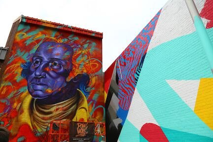 Between May 17 and May 27, 15 artists are creating 15 new murals on buildings throughout NoMa. It's the second year the POW! WOW! festival has brought new murals to the Northeast D.C. neighborhood. (Courtesy Kimberly Cassaday)