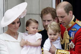 Britain's Prince William holding Prince George, right and Kate, Duchess of Cambridge holding Princess Charlotte, left, on the balcony during the Trooping The Colour parade at Buckingham Palace, in London. (AP Photo/Tim Ireland, File)