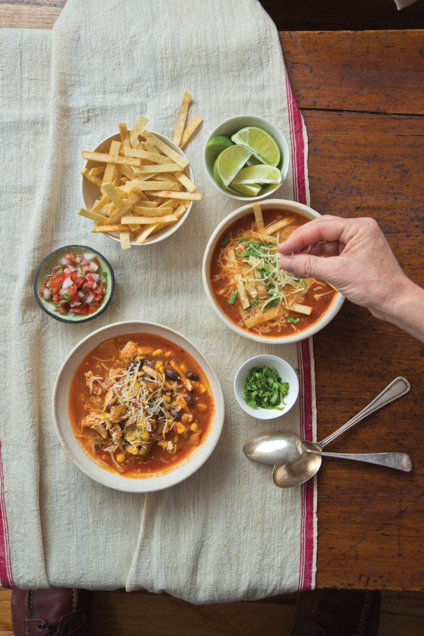 This July 2014 photo shows Mexican tortilla soup in New York. This dish is from a recipe by Katie Workman. (Todd Coleman via AP)