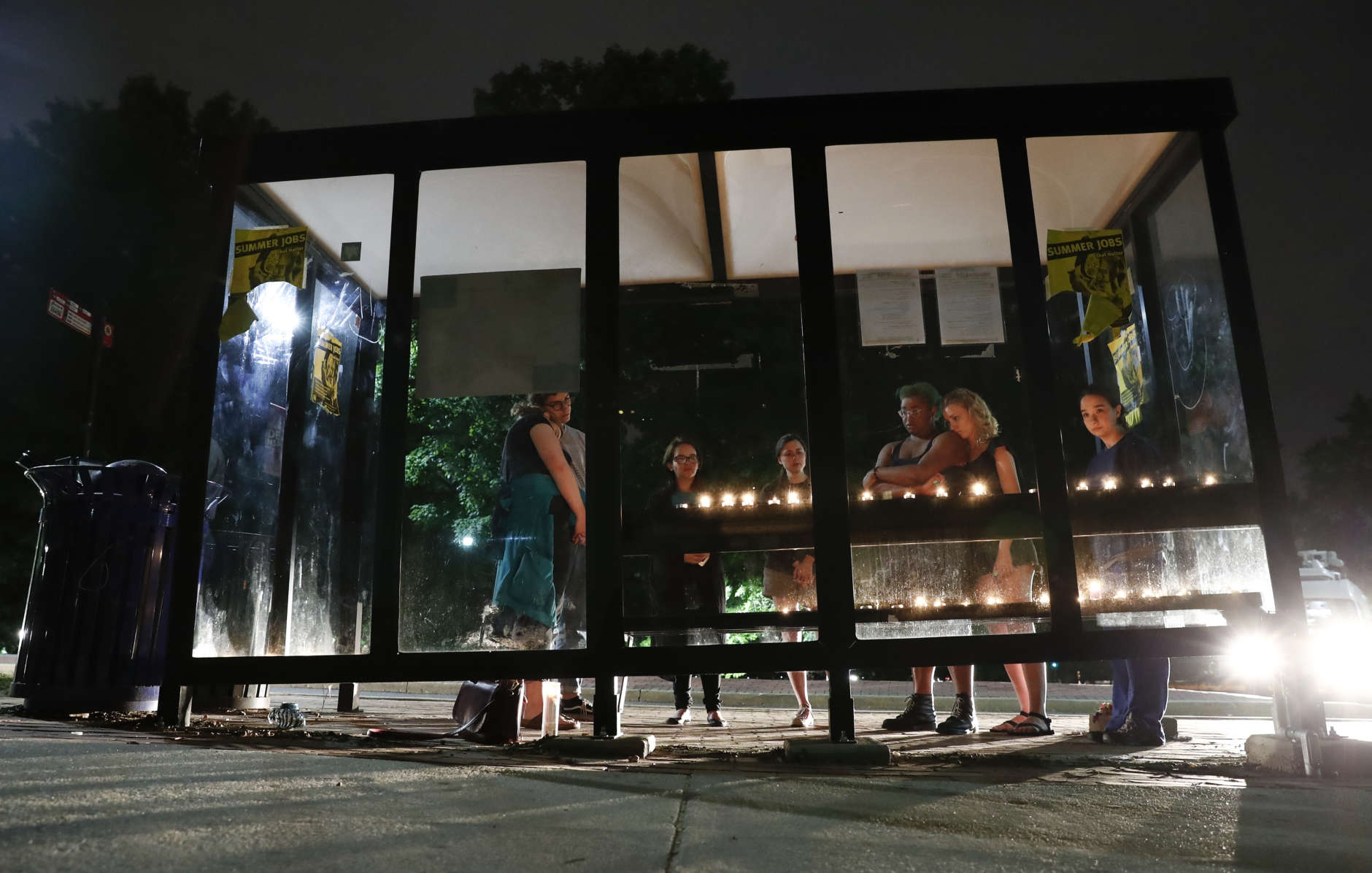 People gathered at the bus stop on University of Maryland campus where Richard Collins III was stabbed. (AP Photo/Carolyn Kaster)