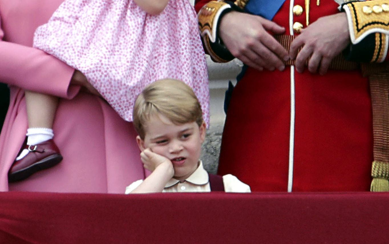 Britain's Prince George gestures,  as he stands on the balcony of Buckingham Palace with other members of the Royal family, after attending the annual Trooping the Colour Ceremony in London, Saturday, June 17, 2017. (Yui Mok/PA via AP)