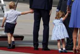 Britain's Prince William, center, and his wife Kate, the Duchess of Cambridge, right, walk with their children Prince George, left, and Princess Charlotte as they leave the airport in Warsaw, Poland, Wednesday, July 19, 2017. The British royal couple is in Poland with their children on a goodwill visit intended to seal friendly ties after Britain leaves the European Union. (AP Photo/Czarek Sokolowski)