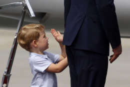 Britain's Prince William, right, holds the hand of his son Prince George as they leave the airport in Warsaw, Poland, Wednesday, July 19, 2017. The British royal couple is in Poland with their children on a goodwill visit intended to seal friendly ties after Britain leaves the European Union. (AP Photo/Czarek Sokolowski)