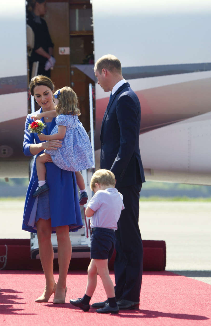 Britain's Prince William, and his wife Kate, the Duchess of Cambridge with their children Prince George and Princess Charlotte arrive at the airport in Berlin, Wednesday, July 19, 2017. The British royal couple is on a three-day-visit in Germany. (Steffi Loos/Pool Photo via AP)