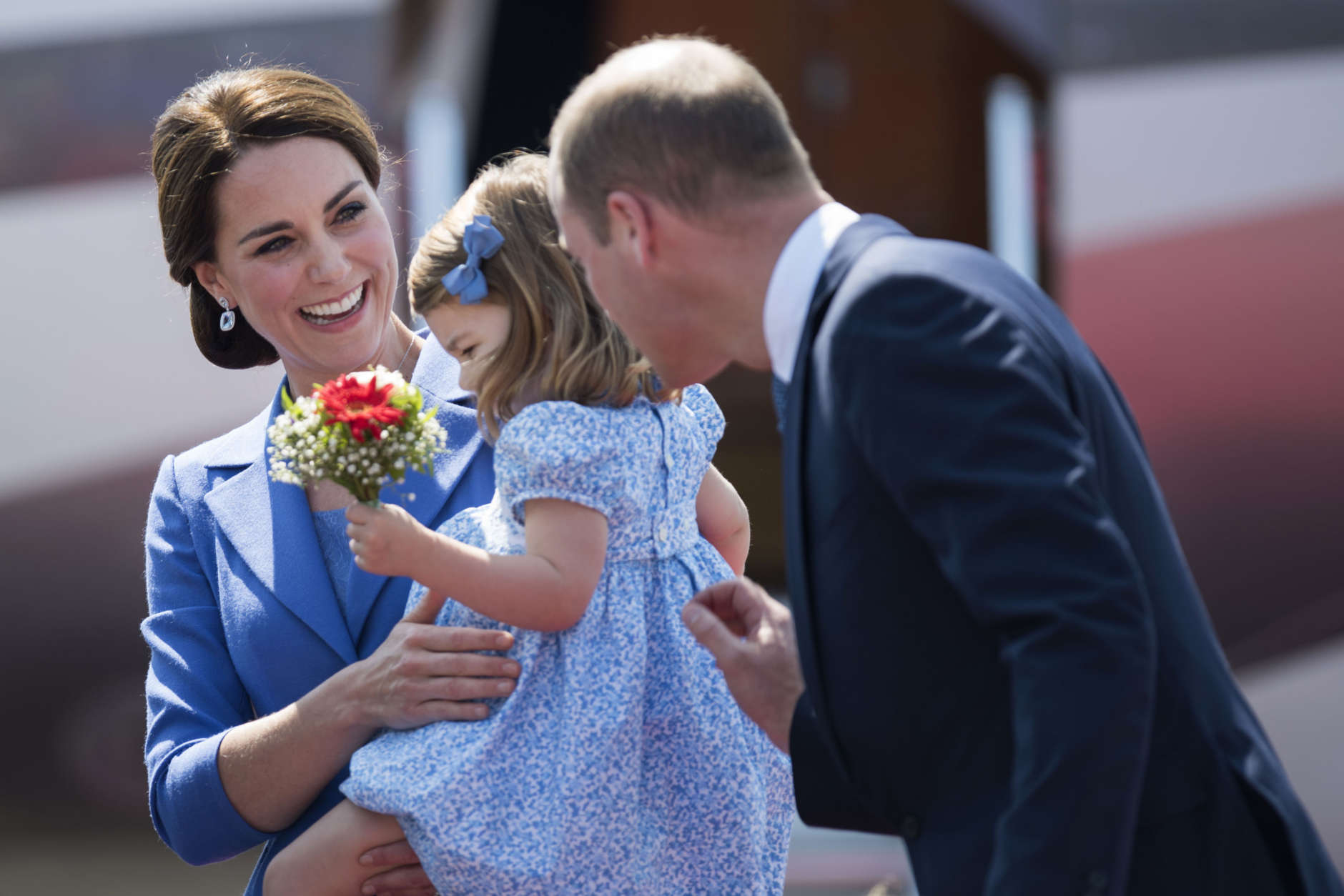 Britain's Prince William, his wife Kate, the Duchess of Cambridge and their daughter Princess Charlotte arrive at the airport in Berlin, Wednesday, July 19, 2017. The British royal couple is on a three-day-visit in Germany. (Steffi Loos/Pool Photo via AP)