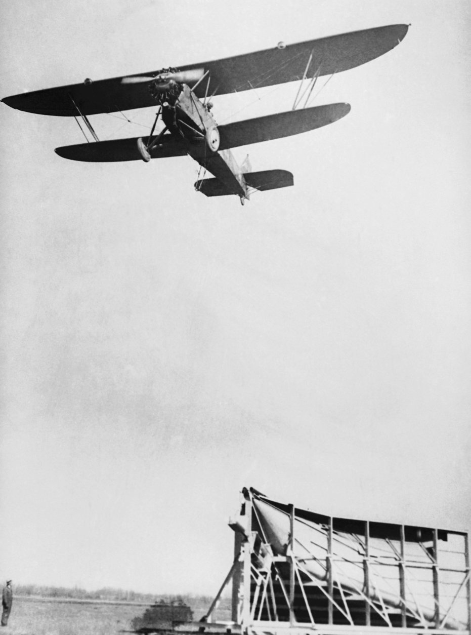 The new system of airmail pick-up and delivery is demonstrated at Hoover Field,  Washington, D.C.,  March 4, 1930. (AP Photo)
